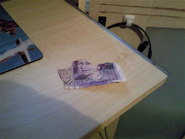 A torn up £20 note