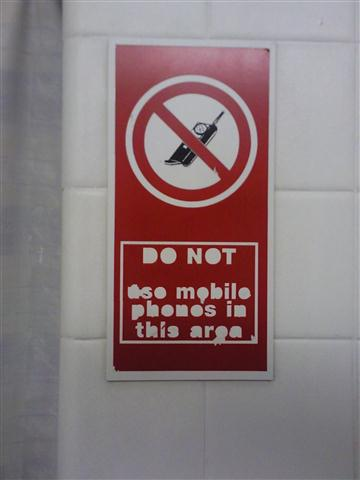 Cubicle mobile phone sign